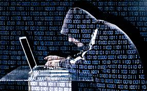 person with hood over computer representing someone hacking a computer, binary behind/overlaying them