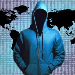 Person with hood over world graphic with binary behind them