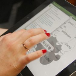 person using ipad, showing how people need to have tech knowledge