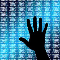Hand in front of binary numbers going down a screen